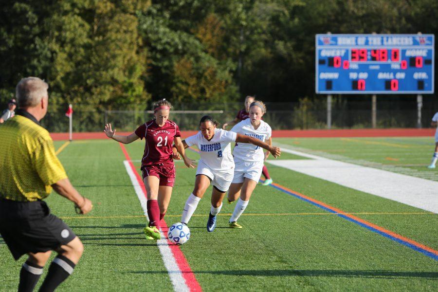 Senior Mia Brennan is action last season at Alumni Field.