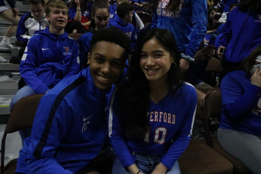 Jalen Chappelle and Jenny Keth cheering on the boy's basketball team at the ECC Championship game.