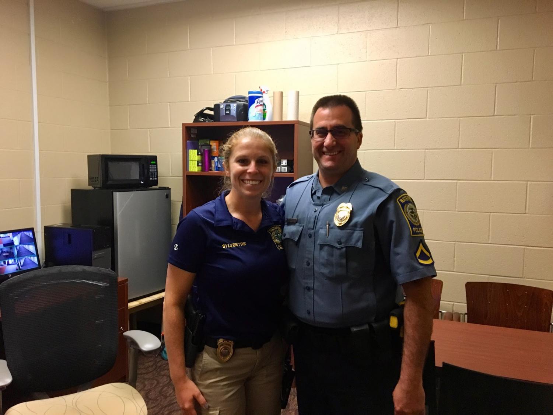 New SRO Megan Sylvestre (left) poses alongside retiring SRO Steve Whitehead (right) inside the security office. September 12, 2019.
